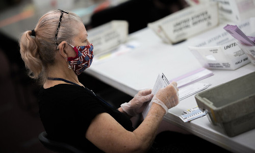 A poll worker wears a mask during the 2020 primary in Nevada.